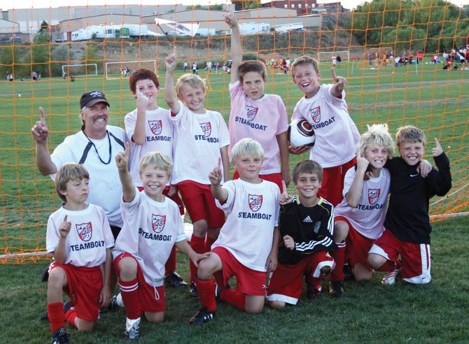 The U10 team coached by Bo Stempel celebrates winning the CYS Cup at Gates Field near Denver. The team topped the Trebol Rapids, 4-2, in the finals to claim the title. The team included, back row from left, Bo Stempel (coach), Robert Harnick, Addison Sandvik, Hudson Heil and Cole Puckett; front row from left, Wyatt Stempel, Trey Seymour, Tallak Myhre, Murphy Bohlmann, Decker Dean and Chase Seymour.