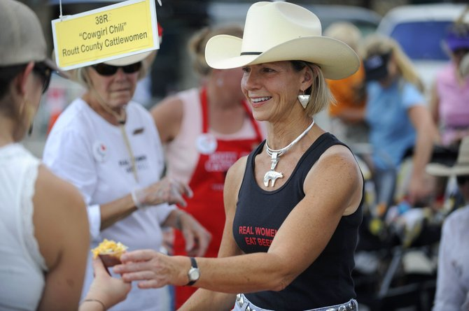 """Liza Jackson, with Routt County CattleWomen, serves up """"Cowgirl Chili"""" in September during Mainstreet Steamboat Springs' Chuck Wagon Chili Challenge in downtown Steamboat Springs. City officials supported an allocation of $45,000 to Mainstreet for 2011 events during a Tuesday discussion of community support funding for more than 40 local groups and organizations."""