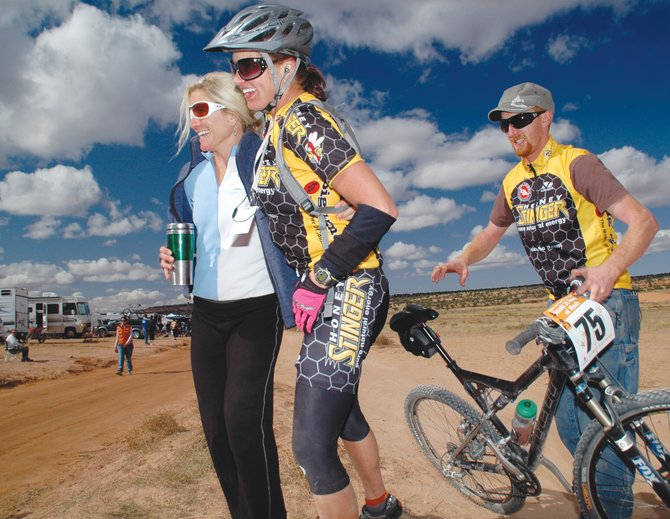 Kelly Boniface and Nate Bird help Kris Cannon step away from her bike for the first time in nearly 24 hours after she locked up second place in the 2008 24 Hours of Moab mountain bike race in Utah. Cannon will race in the solo division again, and Boniface will again serve as a part of her support crew, along with Amy Harris. Bird, meanwhile, will ride as a part of a two-man team.