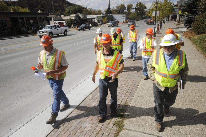 Colorado Department of Transportation, city of Steamboat Springs and Scott Con­tracting officials do the final walk-through of the Lincoln Avenue construction project Thursday afternoon.