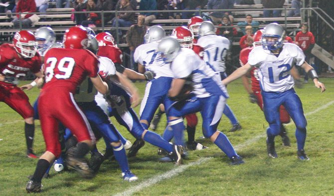 Moffat County quarterback Bubba Ivers hands the ball off duing the Bulldog's 35-7 loss on Friday night.  Glennwood Springs beat Moffat County 35-7 to hand the Bulldogs their second straight loss.