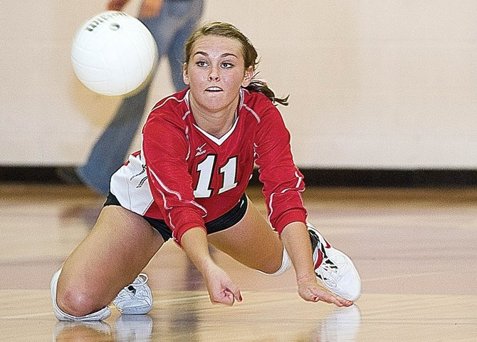 Steamboat Springs High School sophomore Alex Feeley keeps the ball from hitting the floor during the Sailors 3-2 victory against Delta on Friday night at Kelly Meek Gymnasium.