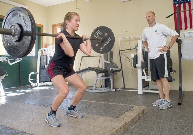 Ski coach Gene Bridgewater works with postgraduate skier Amanda Veth. Bridgewater joined the Steamboat Springs Winter Sports Club in the summer and will be working with the club's FIS-level athletes this season.