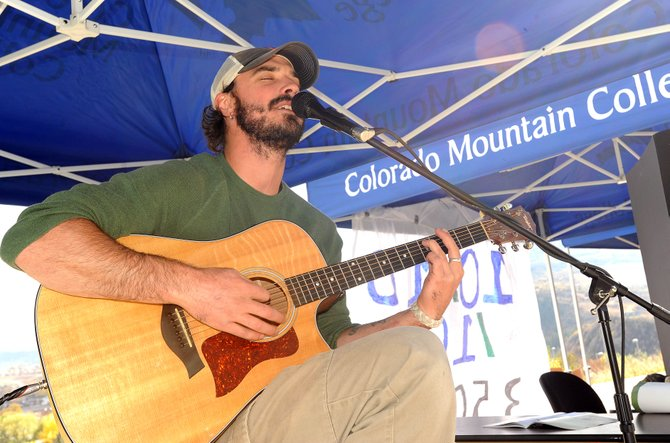 Sam Ayer sings Sunday during a sustainability event at Colorado Mountain College's Alpine Campus in Steamboat Springs.