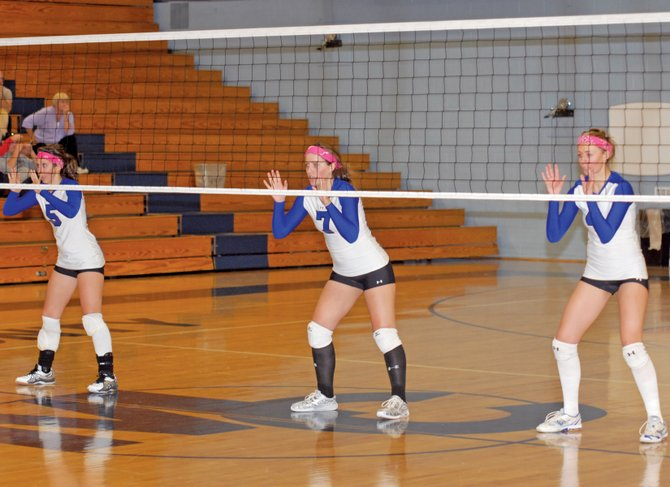 From left, senior Kelly Syvertson, junior Adrie Camp and senior Lauren Roberts prepare for a serve in the fourth and final set of Moffat County High School's Tuesday night volleyball game. The MCHS varsity team beat Palisade, 3-1.