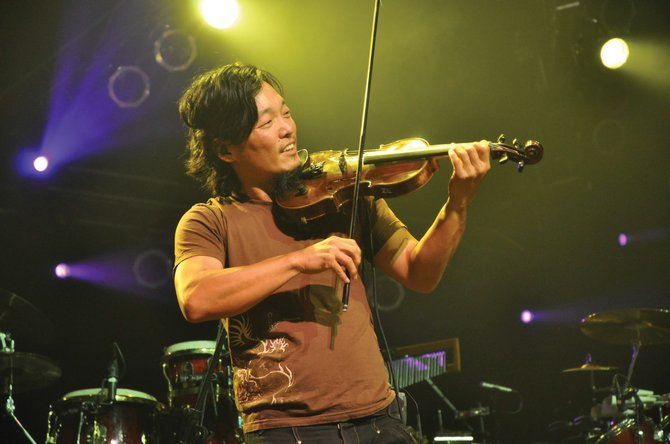 Michael Kang, of String Cheese Incident, performs at the Fourmile Canyon Revival fundraiser Saturday in Broomfield.