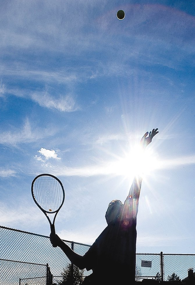 Steamboat Springs High School senior Mirko Erspamer practices his serve Tuesday at the Tennis Center at Steamboat Springs. Erspamer will join eight of his teammates this weekend in Pueblo for the 4A Colorado State High School Tennis Championships.