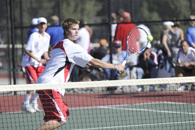 Steamboat Springs' Luke Farny returns a shot during the opening round of the state high school tennis tournament in Pueblo on Thursday. Farny and teammate Kyle Rogers defeated C.J. O'Neil and Jacob Vaughn of Golden, 6-3, 6-4, to advance to the quarterfinals. They lost the second match.