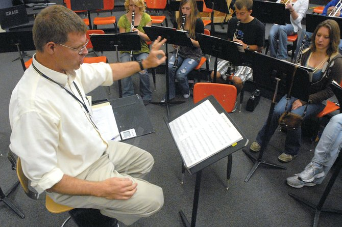 John Bolton, Moffat County High School band director, conducts the wind ensemble Thursday at MCHS. Bolton has been teaching music at MCHS and Craig Middle School since 2004, and has seen the programs grow steadily since then.