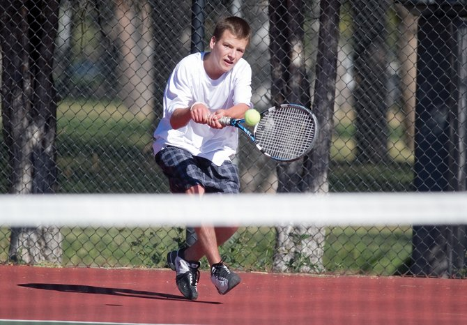 Jack Burger returns a shot  during a 7-5, 6-2 loss to Colorado Academy's Matt Greene in the semifinal match Friday at the state high school tennis championships in Pueblo.