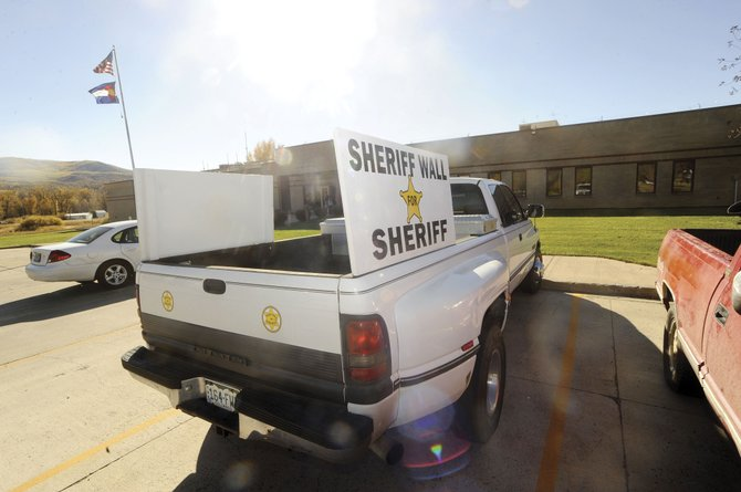Routt County Manager Tom Sullivan has asked Sheriff Gary Wall to remove his truck with the large campaign signs from the Sheriff's Office parking lot.
