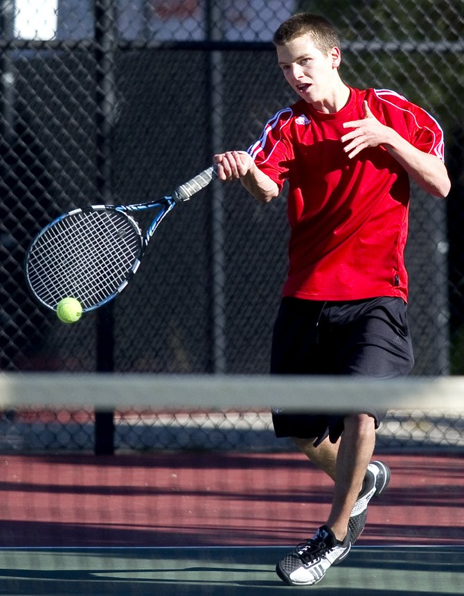 Steamboat Springs' Jack Burger returns a shot during his match against Chris Gang on Saturday morning at Pueblo City Park. Burger lost the match 6-3, 6-3 and finished fourth in the No. 3 singles brackets at the state high school tennis tournament.