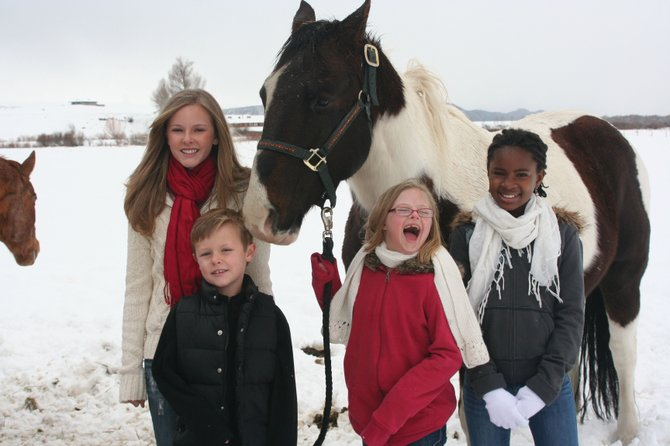 The Metzler children, from left, Brooke, 15; Jackson, 7; Christa, 11; and Fena, 12, often go horseback riding and skiing as a family, parents Tracy and Nick Metzler said. Nick Metzler said the children are learning patience by growing up with Christa, who has Down syndrome.