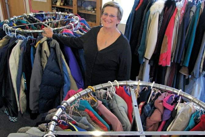 Terri Mansfield, a member of the Love INC board, shows off Tuesday some of the coats donated to the organization at St. Mark's Episcopal and Lutheran Church of Grace, 657 Green St. According to Pat Jones, executive director of Love INC in Craig, the organization has given away 57 coats as of Tuesday morning, with another 319 ready to go.