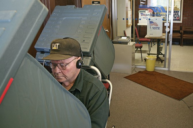 Dick Pearce, 71, a Moffat County resident, casts his vote Tuesday at the Moffat County Courthouse. Two weeks of early voting began Monday. So far, 98 residents have voted early. Early voting polls are open from 8 a.m. to 4:45 p.m. until Oct. 29 at the courthouse, 221. W. Victory Way.