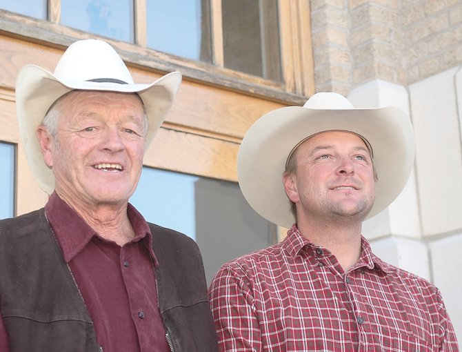Ray Heid and his son, Perk Heid, pause outside the Routt County Courthouse on Tuesday after hearing the County Commissioners approve the use of $513,000 in dedicated Purchase of Development Right funds to conserve their 245-acre North Routt Ranch. The Heid's will donate 42 percent of the value of the permanent conservation easement held by the Colorado Cattlemen's Agricultural Land Trust.