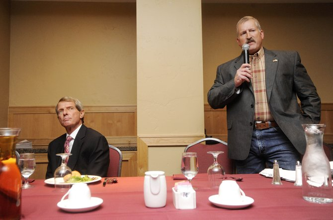 Routt County Sheriff Gary Wall listens to his opponent, Garrett Wiggins, during a Rotary Club of Steamboat Springs candidate forum at The Steamboat Grand.