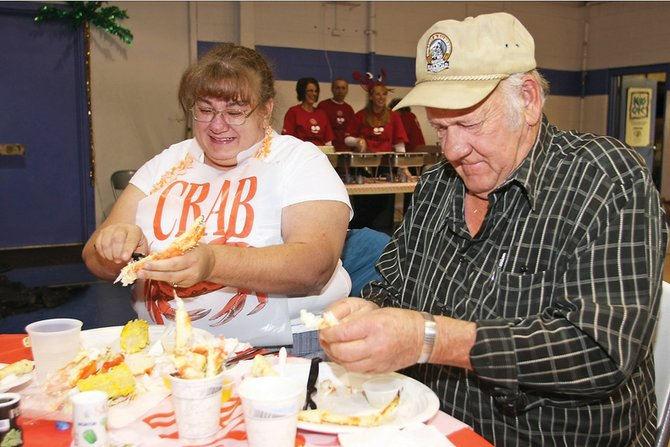 Tammy Mower, left, and her father, John Reynolds, crack their crab legs during last year's Crabfest. This year's event, Crabfest 2010, is scheduled for 6:30 p.m. Saturday at the Boys & Girls Club of Craig. Tickets are $50.