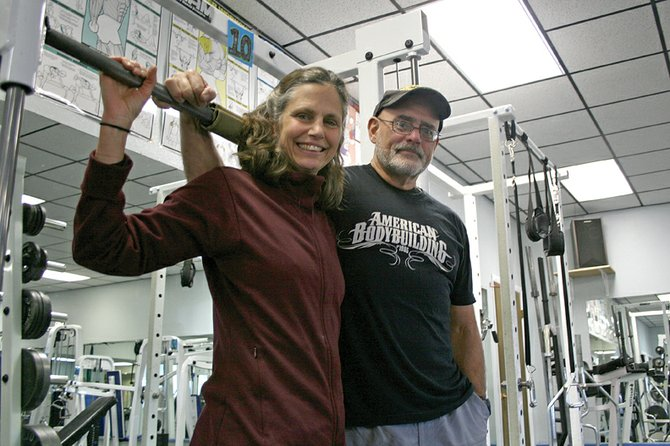 Jim and Barb Gregoire stand Wednesday in the weight room of Trapper Fitness Center, which Jim has managed for about four years. Beginning Nov. 1, the Gregoires will replace Colorado Northwestern Community College administrators as the new operators of the fitness center.