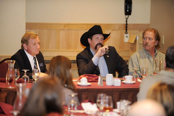 Colorado House District 57 candidates Democrat Steve Ivancie, left, and Libertarian Mike Kien, right, listen to incumbent Randy Baumgardner speak Tuesday during a Rotary Club of Steamboat Springs forum at The Steamboat Grand.