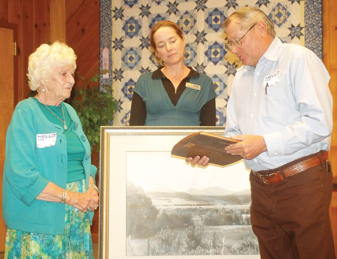 Donna Hellyer, of Hayden, left, accepts the Leckenby Pioneer Award from Jim Stanko and Tread of Pioneers Executive Director Candice Bannister on Tuesday night.