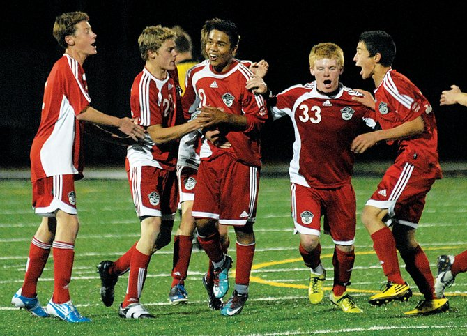 The Steamboat Springs High School soccer team celebrates its second and final goal against Eagle Valley on Tuesday night at Eagle Valley High School in Gypsum. Steamboat Springs won, 2-0.