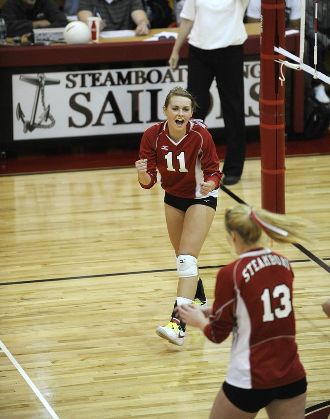 Steamboat Springs High School sophomore Alex Feeley celebrates after scoring a point to win the first game of Thursday night's match against Moffat County High School.