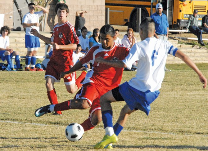 Steamboat Springs' Enrique Lopez maneuvers around Moffat County's Victor Villa during Steamboat's final game of the season against Moffat County High School. Lopez scored the Sailors' only goal in the 3-1 loss.