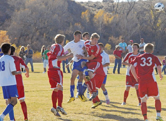 Tracy Mendoza, a Moffat County High School senior, heads in the first of his three goals during Thursday's boys varsity soccer game against Steamboat Springs. The Bulldogs beat the Sailors, 3-1, and will go on to the state playoffs. The playoff schedule will be completed next week.