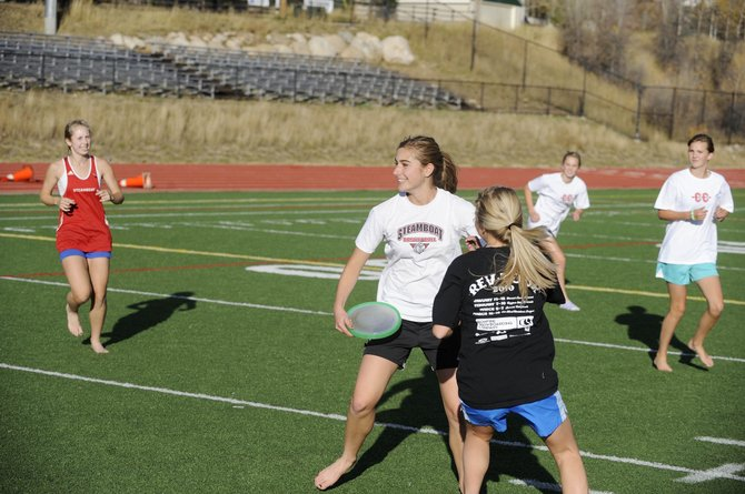 Steamboat Springs High School senior Cassidy Fox looks for a teammate while playing Ultimate Frisbee during cross-country practice Thursday.