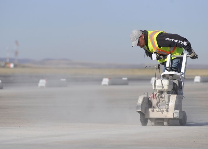 Jason Thomas with Reliable Concrete Cutting works on a new de-icing pad at the Yampa Valley Regional Airport on Thursday.  The pad is being built with grant money the airport received.