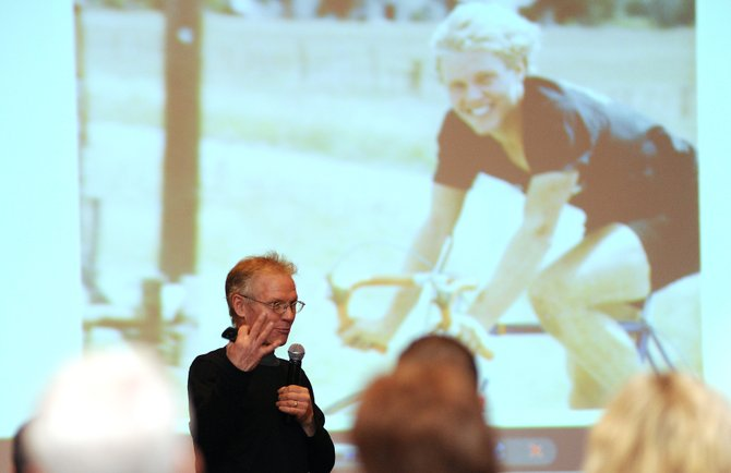 Kent Eriksen speaks Thursday night in front of a picture of himself on a projection screen at the Steamboat Bike Summit in Steamboat Springs. Eriksen laid down roots in Steamboat nearly 35 years ago and has been one of the town's most well-known bike advocates ever since, starting two top-level bike companies.