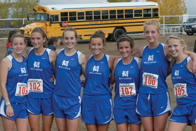 The Moffat County High School girls cross-country team regional competitors are, from left, sophomore Eryn Leonard, freshman Brenna Ciesco, senior Maddy Jourgensen, senior Nike Cleverly, junior Kelly Ciesco, sophomore Bailey Hellander and sophomore Sassy Murray. The girls placed first in the 4A Region 5 meet in Cortez, as did the boys team. Jourgensen and boys runner Chris Zirkle finished first individually in both races.