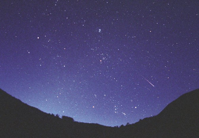 The Taurid meteor shower, currently under way, will peak in early November. Watch for slow, colorful fireballs that point backward toward the Pleiades star cluster in Taurus, the Bull. The Pleiades are at top center in this image.