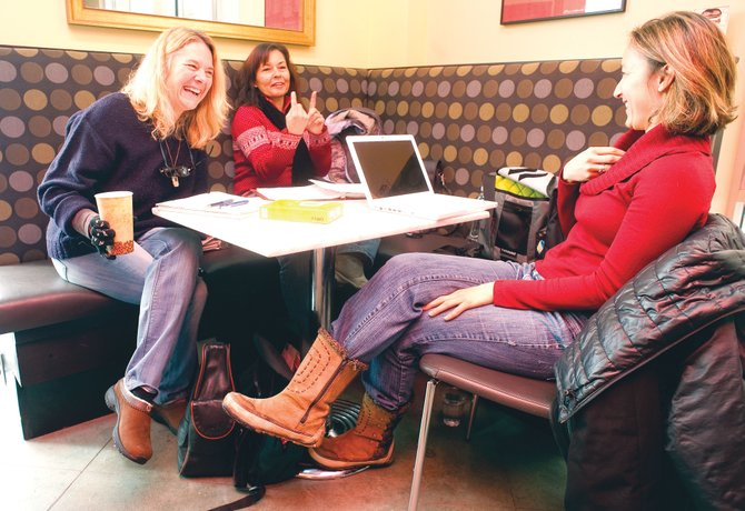 Local writers, from left, Lyn Wheaton, Jill Murphy Long and Alexandra Pallut discuss their work at Amante Coffee on Wednesday afternoon. Bud Werner Memorial Library is launching a support program alongside National Novel Writing Month.