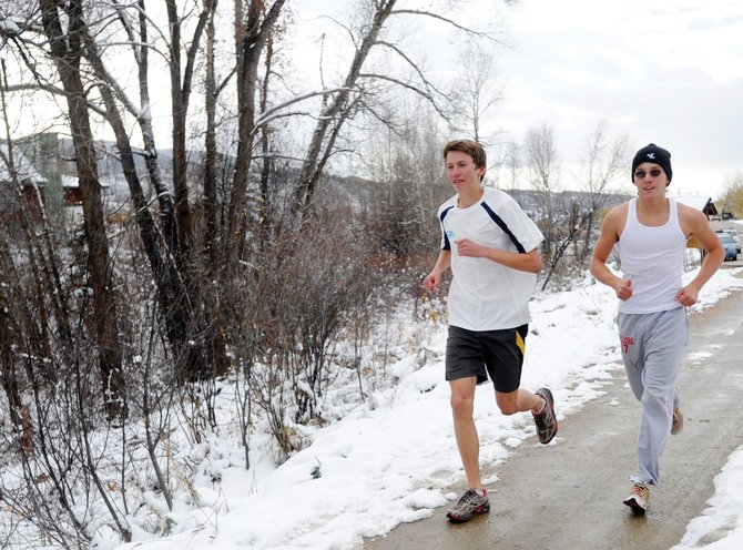 Asher Rohde, left, runs with teammate Colton Lewer down the Spring Creek Trail on Wednesday during one of the season's final cross-country practices. Rohde will join Jack Burger on Saturday to compete in the state cross-country meet in Aurora.