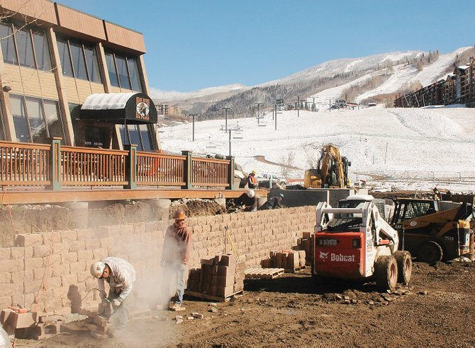 Workers for Gallegos Corp., of Wolcott, began this retaining wall on the new Bear River Bar & Grill deck at the base of the ski area Wednesday. It's part of a new glassed-in outdoor dining area for skiers.