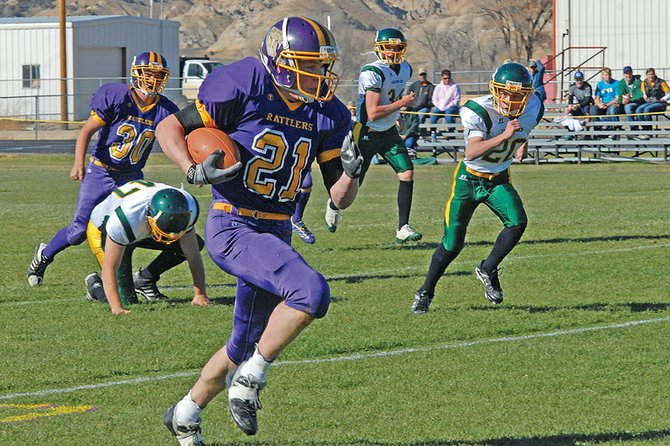 Rattlers running back Sean Rietveld gains yardage in Little Snake River Valley's playoff game Friday against Farson-Eden in Baggs, Wyo. The Rattlers won, 64-0, and advanced to the second round of the six-man Wyoming state playoffs. They will play Kaycee on Nov. 6.