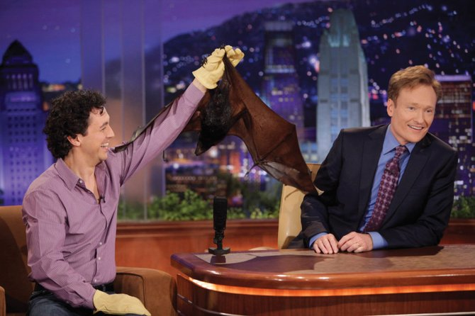 Rob Mies, left, holds up a live bat for talk show host Conan O'Brien in October 2009. Mies will lead a live bat encounter at 3:30 p.m. Sunday at Library Hall at Bud Werner Memorial Library.