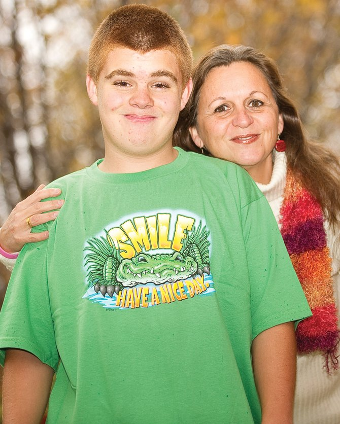 James Dickson gets a hug from his mom, Babette, outside the family's home in Steamboat Springs last week. Babette Dickson said she's seen positive results since she started giving James medical marijuana in the form of edibles or tinctures.