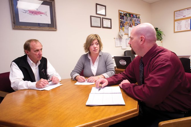 Sara Craig-Scheckman, center, talks with Soroco High School Principal Dennis Alt, right, and Superintendent Scott Mader, left, about a recent grant from the Craig-Scheckman Family Foundation. The foundation gave $175,000 to local organizations last year.