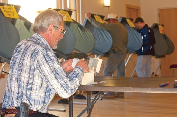 Election judge Frank Bradley counts the number of voters who came through the doors of the Steamboat Springs Community Center to cast their ballots on Election Day.