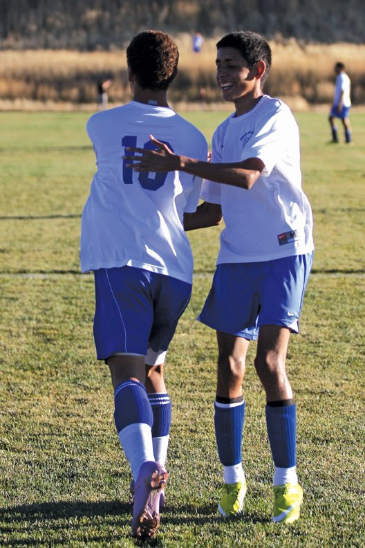 Moffat County soccer player Johnny Landa, right, congratulates teammate Alan Flores after the MCHS boys varsity soccer team's game against Palisade earlier this season. The team had its best season ever this year, with an overall record of 11-5, 7-3 in the Western Slope League.