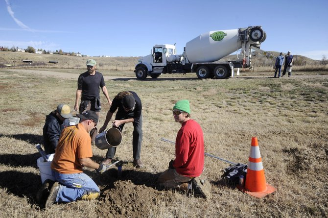 Volunteers pour concrete Saturday to secure posts for new disc golf baskets at Dry Creek Park in Hayden. A $6,000 LiveWell Northwest Colorado grant was used to pay for the new 9-hole course.