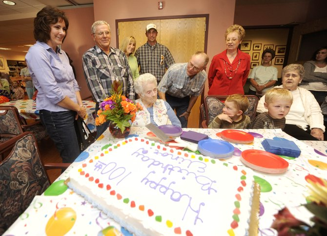 Doak Walker Care Center residents, family and children from the GrandKids Child Care Center sing Happy Birthday on Wednesday to Doak Walker resident Elinor Hockett, who celebrated her 100th birthday Tuesday.