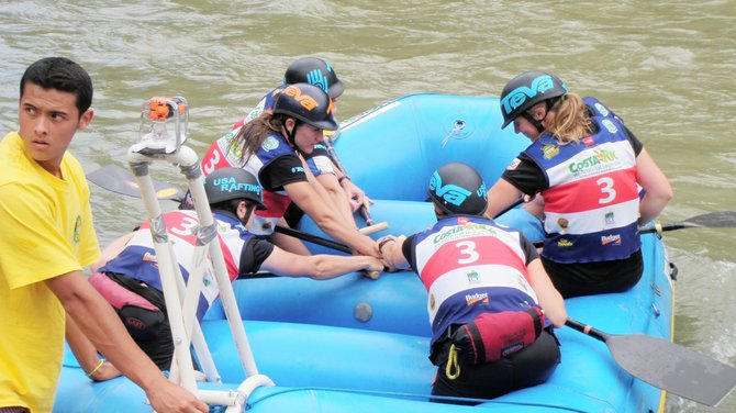 Sarah Hamilton, middle left with the orange and black helmet, and the women of the U.S. Rafting Team prepare for a race last month during a pre-world championship event in Costa Rica. Hamilton, who has spent the past several years kayaking in and around Steamboat Springs and lives in Oak Creek, said the trip and her spot on the team are a dream come true.