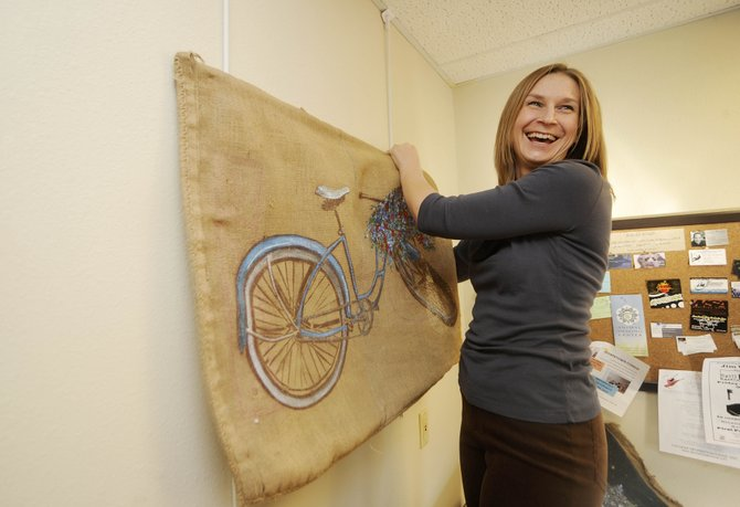 Stagecoach resident Megan Morgan shows her bicycle-inspired coffee bag art from 5 to 8 p.m. today at Spill the Beans.