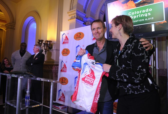 Event organizers for the Quiznos Pro Challenge announced the 11 cities that will be involved with the 2011 international pro-cycling competion at a gathering Thursday at the state Capitol in Denver. Chris Carmichael, center, a former Olympic team cyclist, represented the city of Colorado Springs. With him is Quiznos spokeswoman Ellen Kramer. Gov. Bill Ritter also was on hand with former Bronco and avid cyclist Shannon Sharpe in the background. The race will open in Colorado Springs with a prologue time trial.