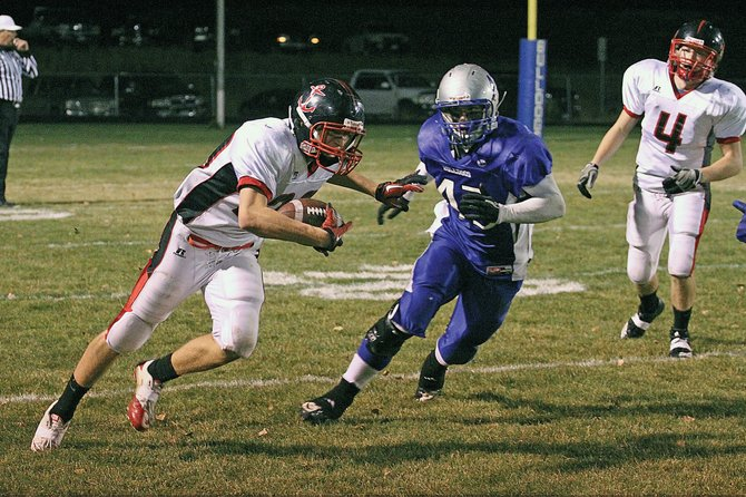 Steamboat Springs Sailor Kevin Gower turns the corner against a Moffat County Bulldogs defender Friday night in Craig. The Sailors dropped the game, 42-8, to the Bulldogs leaving the team at 0-10 on the season.