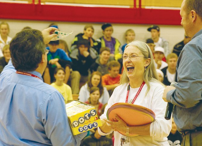 Dot Haberlan reacts during a surprise assembly Wednesday inside the Kelly Meek Gymnasium at Steamboat Springs High School. Haberlan, who oversees nursing at all Routt County schools for the Northwest Colorado Visiting Nurse Association, was awarded School Nurse of the Year on Friday by the Colorado Association of School Nurses.